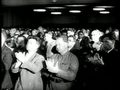 vídeos de stock, filmes e b-roll de dictator joseph stalin walking to congressional seat. soviet audience clapping. vs foreign minister vyacheslav molotov speaking at podium & audience.... - 1930 1939