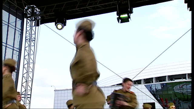 dictatorship of alexander lukashenko soldiers performing cossack dance on stage audience clapping along female soldiers dancing in uniform on stage... - figure skating stock videos & royalty-free footage