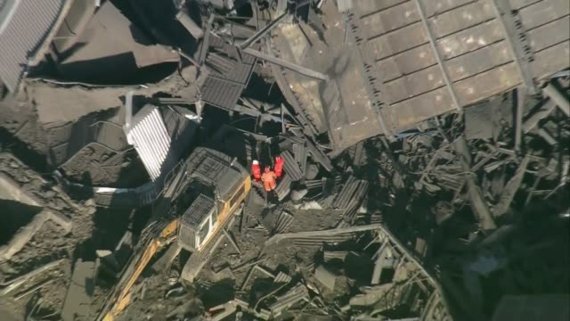 hopes fade for missing people air view / aerial members of the emergency services amidst the rubble of the collapsed building pull out - didcot stock videos and b-roll footage