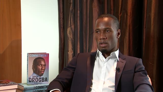 london int drogba interview with autobiography 'commitment' book behind sot there's a lot of things to do there to improve people's lives i'm lucky... - biographie stock-videos und b-roll-filmmaterial