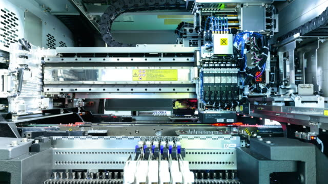 ic die bond machine. timelapse - electronics industry stock videos & royalty-free footage