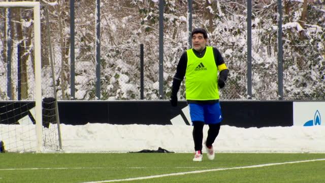 "diego maradona, argentinian football legend, playing football at fifa hq in zurich, looking unfit - ""bbc news"" stock-videos und b-roll-filmmaterial"