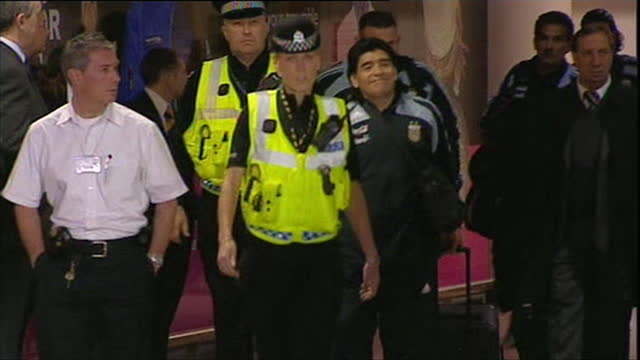 diego maradona argentinian soccer legend arriving at glasgow airport ahead of his international managerial debut against scotland - glasgow international airport stock videos & royalty-free footage