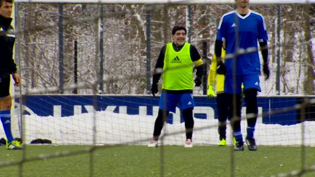 "diego maradona, argentinian soccer legend, playing football at fifa hq in zurich, looking unfit - ""bbc news"" stock-videos und b-roll-filmmaterial"