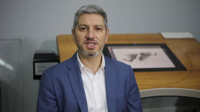 diego osvaldo oller, general manager of production of mint, explains the detail of the printing of the peso banknotes at the casa de moneda on august... - banknote stock videos & royalty-free footage