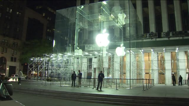 diehard apple fans camp out at a retail apple store to buy new iphone 5s exterior of apple store on eve of iphone 5s launch at apple retail store -... - mp3 player stock videos & royalty-free footage
