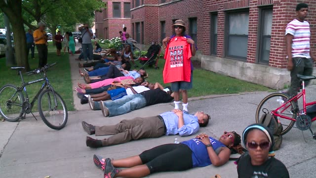 wgn diein demonstration in front of obama's chicago home on july 8 2016after a week that included two black men being killed by police officers and... - police brutality stock videos and b-roll footage