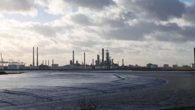 Diesel fuel storage silos sit on the estuary shoreline at the Thames Oil Port Project a joint venture operated by Royal Vopak NV Royal Dutch Shell...