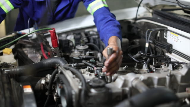 diesel technician working on an engine. - engine stock videos & royalty-free footage