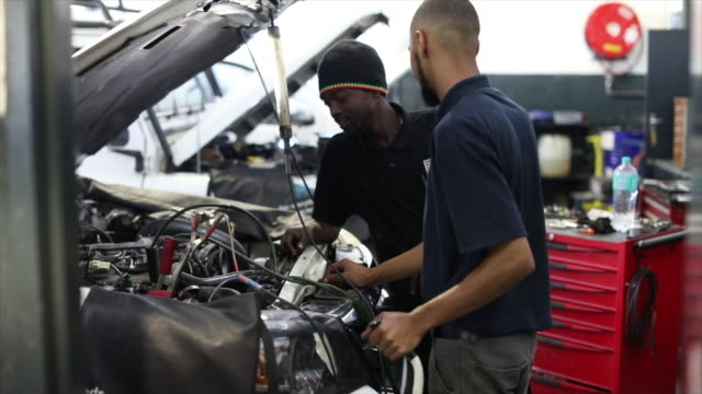 diesel technicians working on an engine. - engine stock videos & royalty-free footage