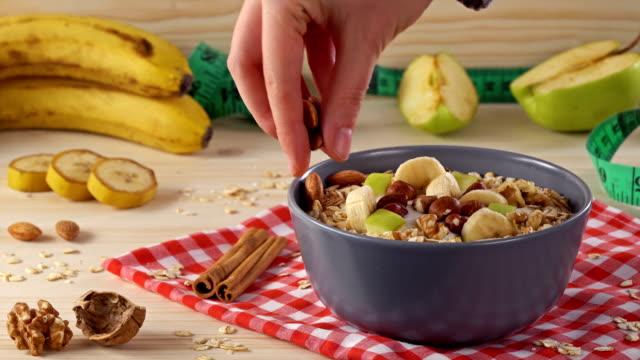 4k diet, bowl of yogurt, berries and nuts. - slip banana stock videos & royalty-free footage
