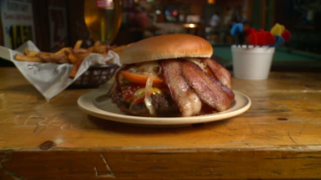 different close up shots of a juicy bacon cheeseburger made in chicago - cheeseburger stock videos & royalty-free footage