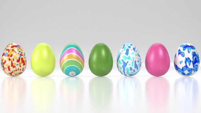 different colorful decorated easter eggs on reflective white surface in 4k resolution - animal colour stock videos & royalty-free footage