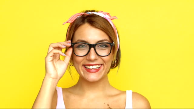 4k different faces of a woman - yellow background stock videos & royalty-free footage