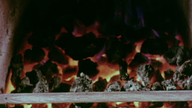 1967 MONTAGE Different fireplaces with fires burning / Handsworth, West Midlands, England