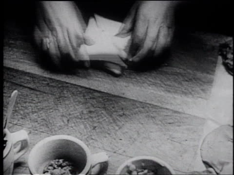 1945 montage different food and beverages being prepared / united states - frank capra video stock e b–roll