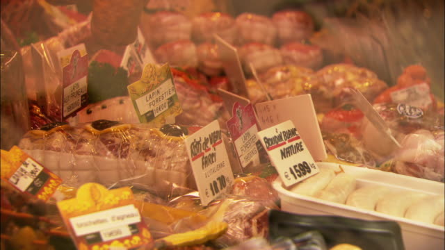 CU Different kinds of meat for sale in display case in butcher shop / Paris, France