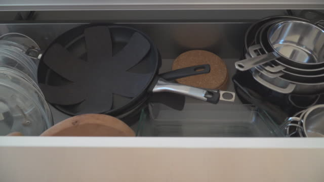 different kitchenware in kitchen drawer - cooking pan stock videos & royalty-free footage