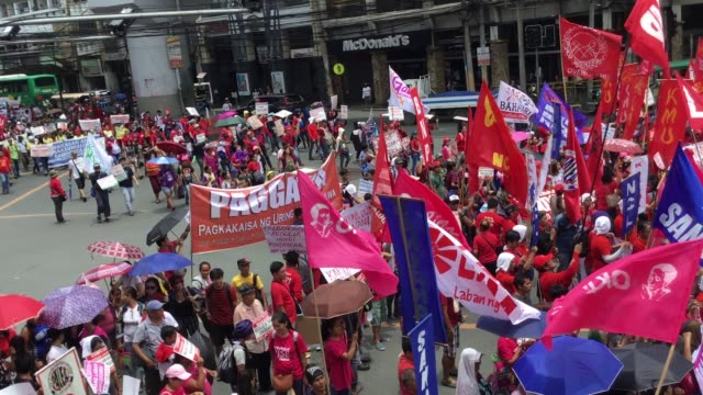 different militant and labor groups participated a protest showing their dismay to press rodrigo duterte according to the group the president had... - militant groups stock videos and b-roll footage