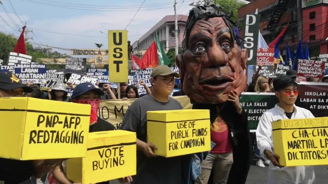 different militant groups headed by bagong alyansang makabayan protested in streets of manila on friday to question the results of the 2019 midterm... - militant groups stock videos and b-roll footage