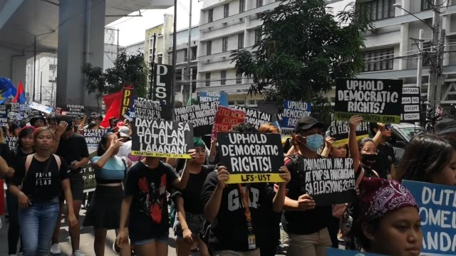 different militant groups headed by bagong alyansang makabayan protested in streets of manila on friday to question the results of the 2019 midterm... - gewerkschaft stock-videos und b-roll-filmmaterial