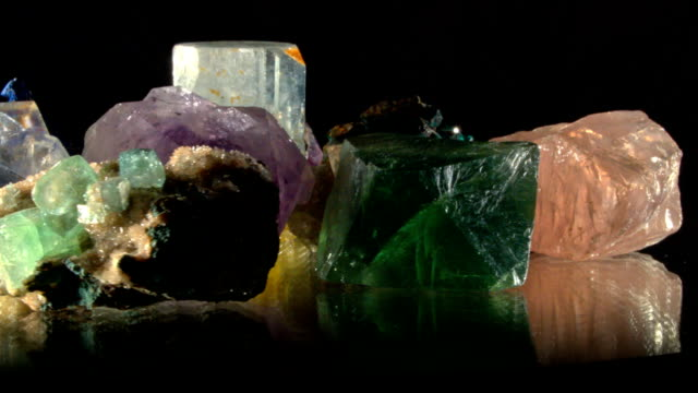different minerals turning on black - fluorite stock videos & royalty-free footage