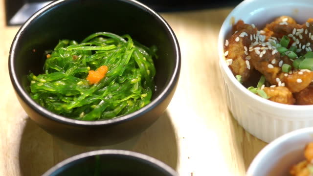 different mini canape on table in the restaurant. - seaweed stock videos & royalty-free footage