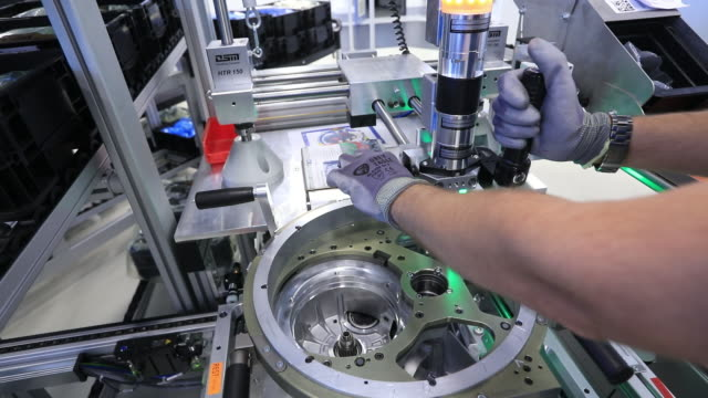 stockvideo's en b-roll-footage met different parts of luxury automobile production process at the schaeffler technologies ag co kg factory in herzogenaurachbavariagermany on tuesday... - automobile industry