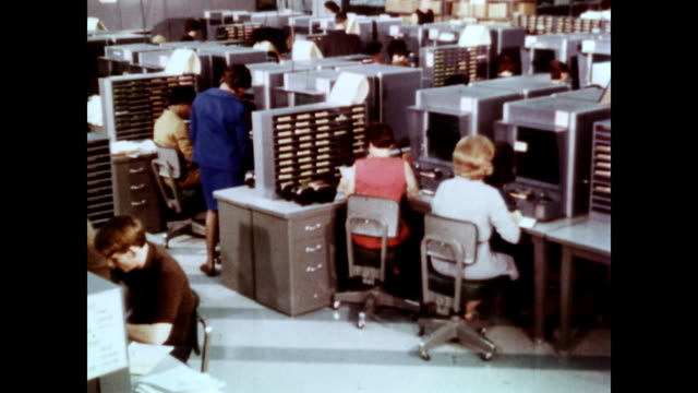 / CU different problems with tax returns / worker at microfiche machine Tax Payer Service Division on January 01 1965 in Martinsburg West Virginia