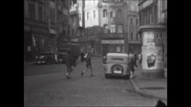 different shots in the centre of the city Eisenach with people cars trams and sights in the 1950s