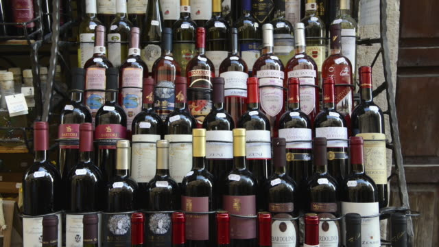 ms td different type of italian wine bottles in front of shop / bardolino, verona, italy - wine bottle stock videos & royalty-free footage