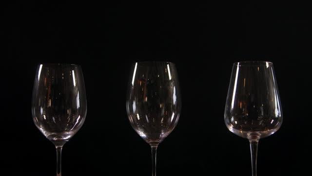 vídeos y material grabado en eventos de stock de different types of wine glasses - fundido en negro