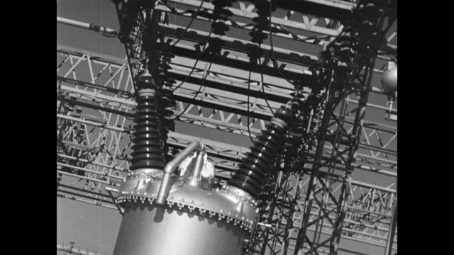 vídeos y material grabado en eventos de stock de / different views of a dam's structure including the large walls / cu of electricity pylons powering the dam / man working the dam's control panel /... - 1937