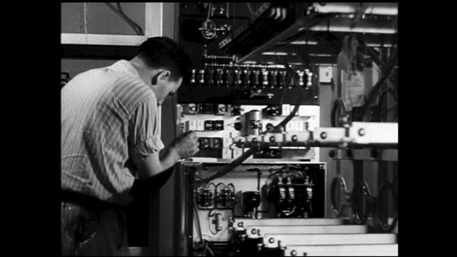 different views of men on the ladder working with wires on the ceiling; man working with wires on wall unit, clipping wiring, installing - 1940 1949 stock videos & royalty-free footage