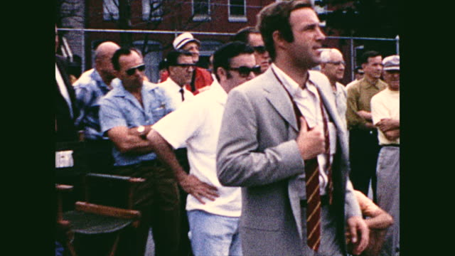 different views of the actor james caan getting ready for a take and doing a take playing basketball with boys; director jack smight adjusts caan's... - film director stock videos & royalty-free footage