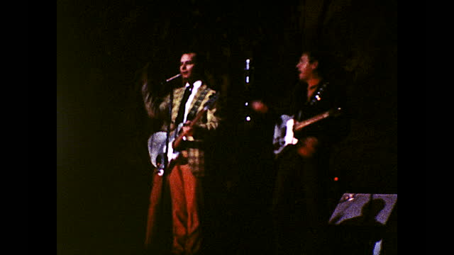different views of two men both with guitars singing on stage and singing to each other - 1960 1969 stock videos & royalty-free footage