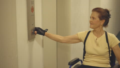 differently abled senior woman uses elevator - accessibility stock videos & royalty-free footage