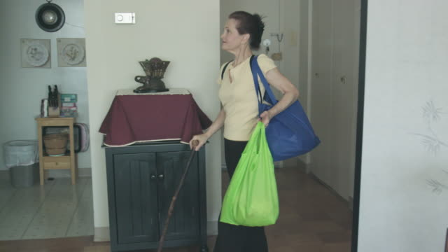 differently abled senior woman with groceries - orthopedic equipment stock videos & royalty-free footage