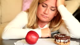 Difficult choice between healthy or junk food, diet concept