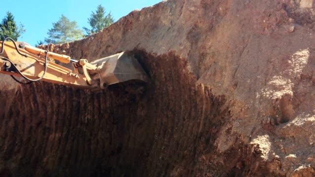 digger digging for quartz sandstone - quartz stock videos and b-roll footage