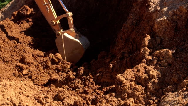 digger digging for quartz sandstone - bulldozer stock videos and b-roll footage