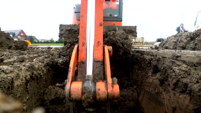 digger digging grave as london cemetery expands due to number of deaths during coronavirus pandemic - construction vehicle stock videos & royalty-free footage