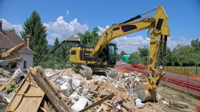 cs digger sorting construction waste at the demolition site of an old building - construction vehicle stock videos and b-roll footage