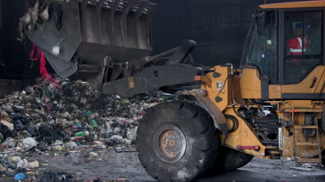 digger used at a recycling centre, uk - construction machinery stock videos & royalty-free footage