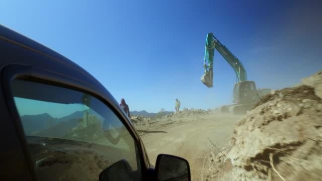 vídeos de stock, filmes e b-roll de digger working on the main road of east bhutan - ocidentalização