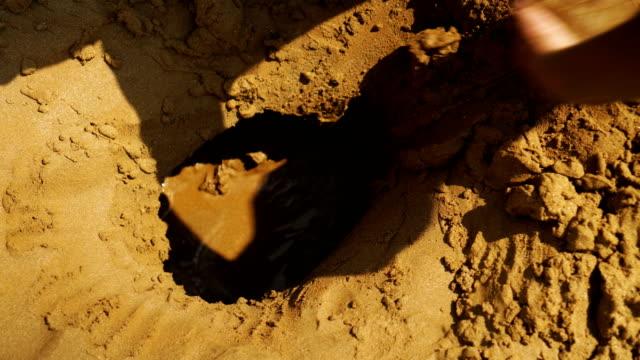 Gräva hall i sanden