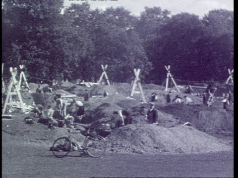 digging trench shelters in hyde park - trench stock videos & royalty-free footage