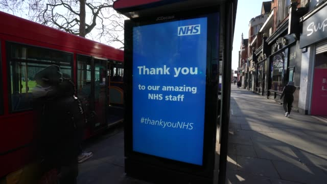 "march 26: a digital advertisement screen on a bus shelter displays a ""thank you to our amazing nhs staff"" poster as part of a nationwide... - advertisement stock videos & royalty-free footage"