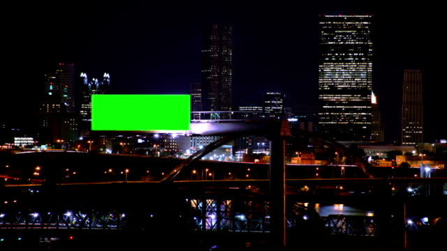Digital advertising board in city at night