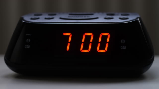 digital alarm clock, 6.59 to 7.00. - clock stock videos & royalty-free footage